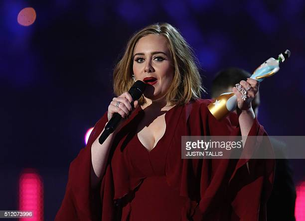 British singer Adele reacts after receiving the British Female Solo artist award during the BRIT Awards 2016 in London on February 24, 2016. / AFP /...