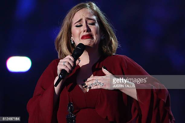 British singer Adele reacts after receiving the Global Success award during the BRIT Awards 2016 in London on February 24 2016 / AFP / JUSTIN TALLIS...