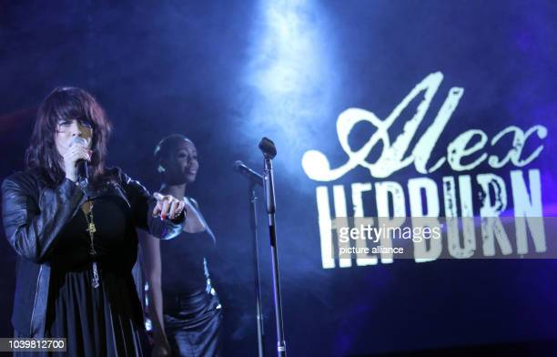 British singer Alex Hepburn performs during the IBFWM middleweight heat between Felix Sturm of Germany and Predrag Radosevic of Montenegro at the...