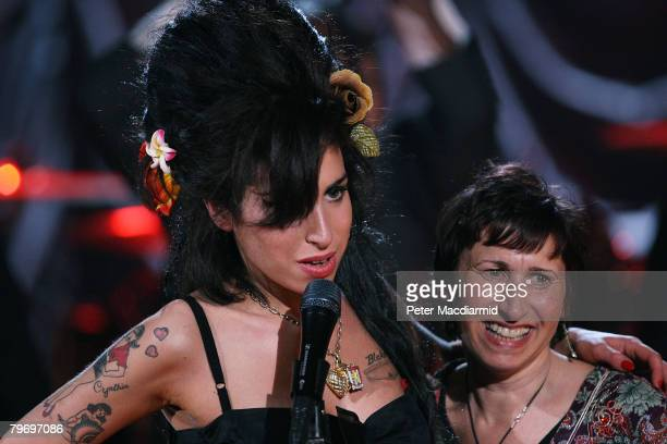 British singer Amy Winehouse hugs her mother Janis Winehouse after accepting a Grammy Award at the Riverside Studios for the 50th Grammy Awards...