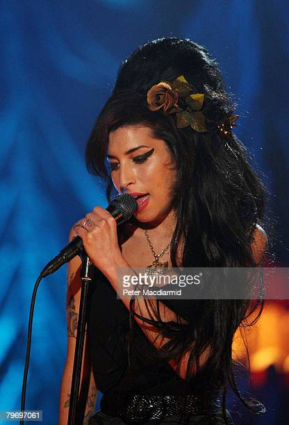 British singer Amy Winehouse performs at the Riverside Studios for the 50th Grammy Awards ceremony via video link on February 10 2008 in London...