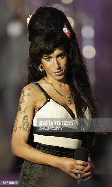 British singer Amy Winehouse performs during the 46664 concert in honour of Nelson Mandela's 90th birthday in Hyde Park central London on June 27...