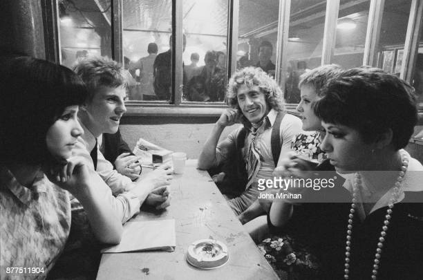 British singer and actor Roger Daltrey of rock group The Who with members of the cast during shooting of drama film Quadrophenia UK 25th October 1978