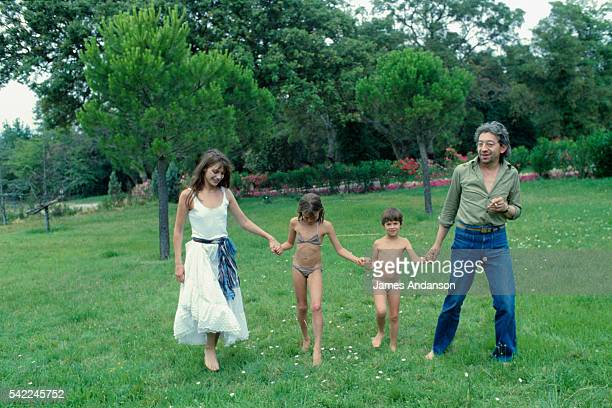 British singer and actress Jane Birkin and French singer and composer Serge Gainsbourg with their daughter Charlotte and Birkin's daughter Kate Barry...