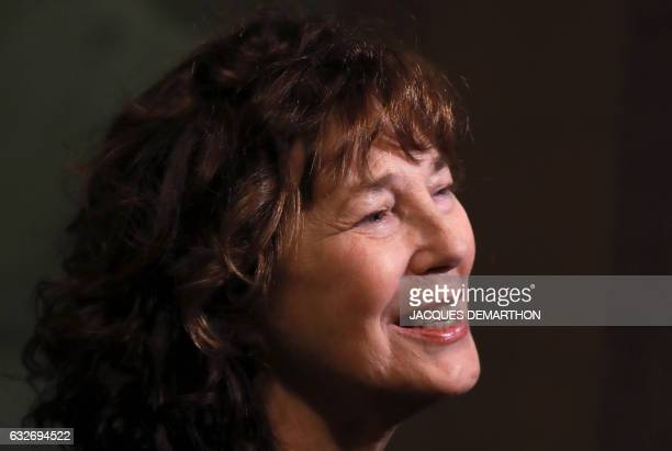 British singer and actress Jane Birkin poses as she arrives at the Cinematheque Francaise for the opening of an exhibition dedicated to her work on...