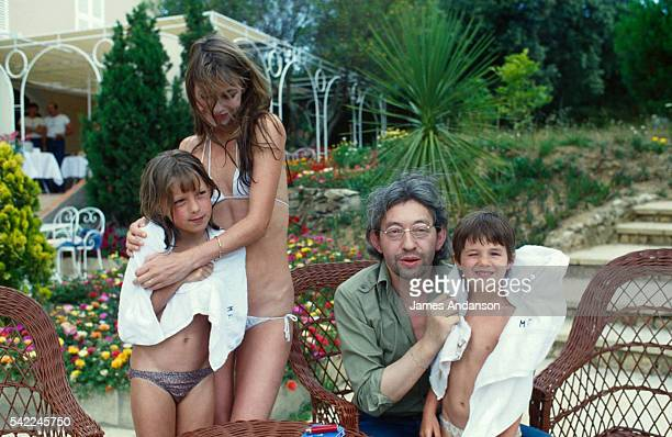 British singer and actress Jane Birkin with French singer and composer Serge Gainsbourg with their children during summer holidays in SaintTropez...