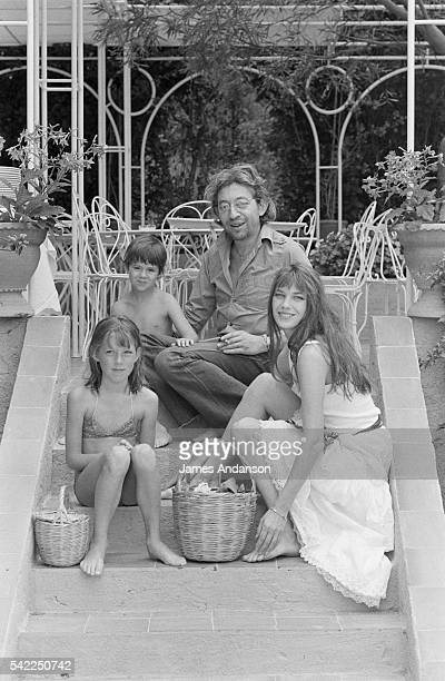 British singer and actress Jane Birkin with French singer and composer Serge Gainsbourg and their daughter Charlotte and Birkin's daughter Kate Barry...