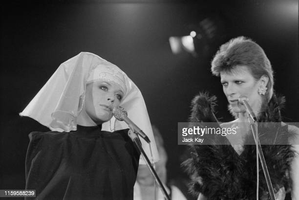 British singer and actress Marianne Faithfull on stage with David Bowie at a live recording of 'The 1980 Floor Show' for the NBC 'Midnight Special'...