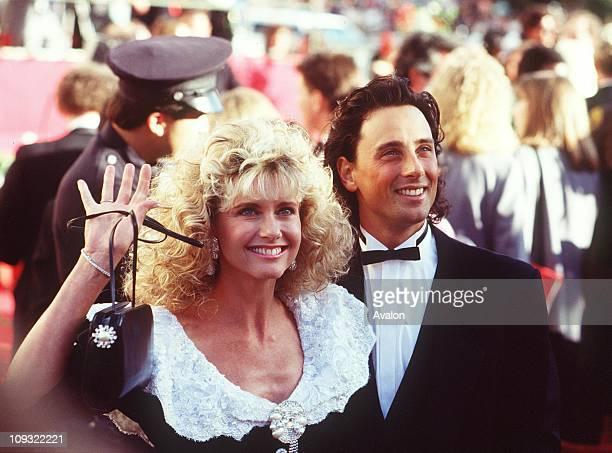 British Singer and Actress Olivia Newton-john with husband MATT LATTANZI, at the 1989 Academy Awards.