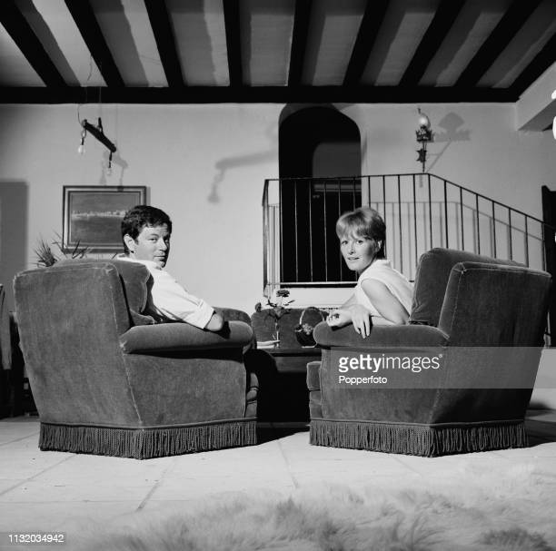 British singer and actress Petula Clark pictured with her husband Claude Wolff at home in October 1963.