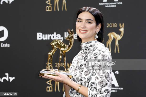 British singer and award winner Dua Lipa poses with award during the 70th Bambi Awards winners board at Stage Theater on November 16 2018 in Berlin...