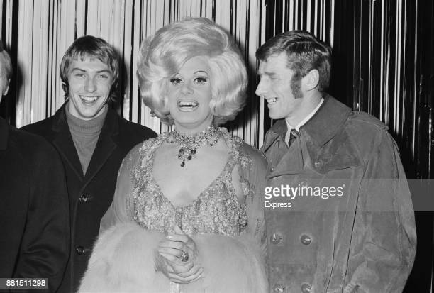 British singer and entertainer Danny La Rue with Manchester City FC players Tonny Book and Derek Jeffries UK 23rd January 1971