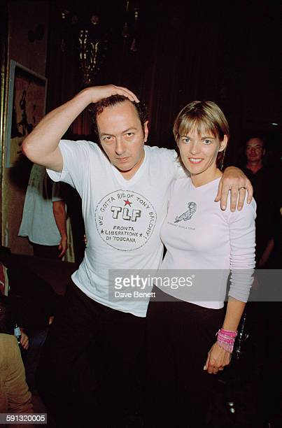 British singer and musician Joe Strummer with his wife Lucinda Tait at a party for the documentary film 'The Clash Westway to the World' at the...