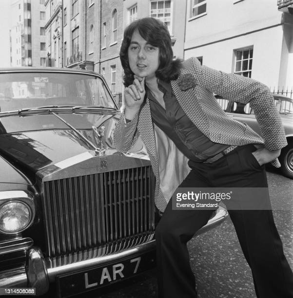 British singer and musician Paul Da Vinci posing with a Rolls Royce, UK, 15th May 1974. He performed the lead vocals for the song 'Sugar Baby Love'...