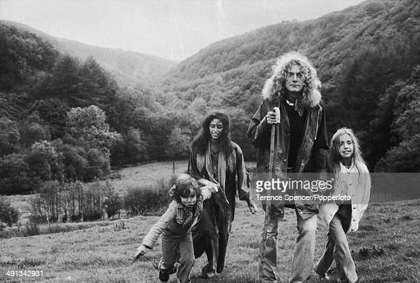 British singer and musician Robert Plant of rock group Led Zeppelin, walks in a field with his family near their home in Machynlleth, Wales on 15th...