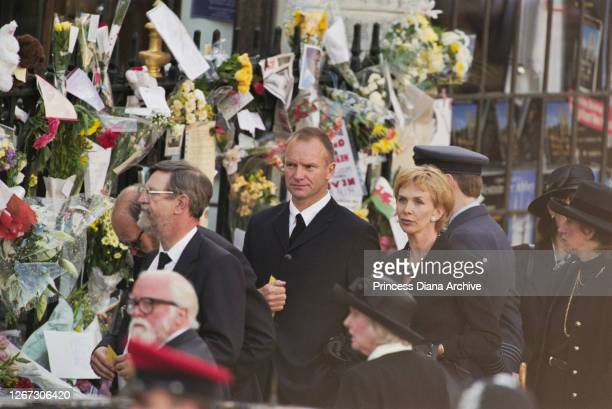 British singer and musician Sting and his wife Trudie Styler among mourners passing flowers and messages of condolence at the funeral service for...
