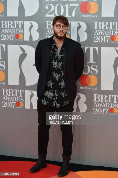 British singer and songwriter James Arthur poses on the red carpet arriving for the BRIT Awards 2017 in London on February 22, 2017. / AFP / NIKLAS...