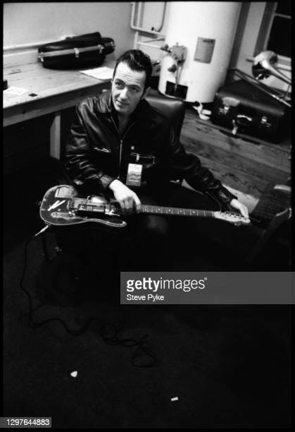 British singer and songwriter Joe Strummer backstage before a concert with The Pogues at The Town and Country Club, London, December 1988.