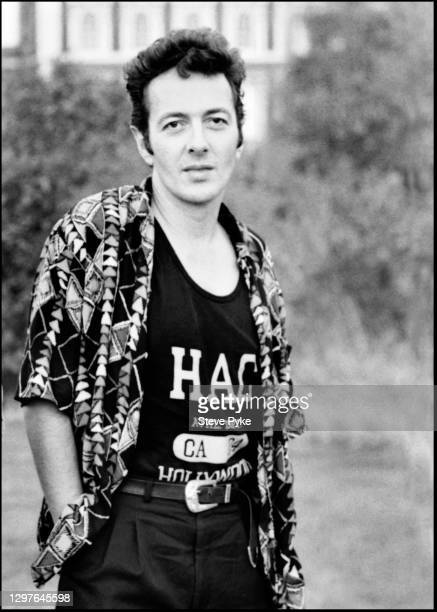 British singer and songwriter Joe Strummer between rehearsal sessions, Caledonian Fields, North London, 15th July 1991.