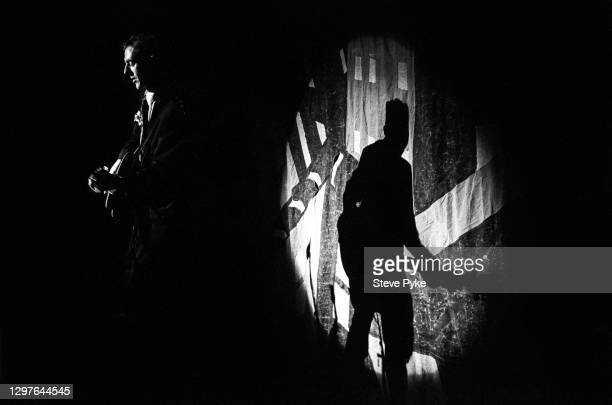 British singer and songwriter Joe Strummer performing with The Pogues at The Town and Country Club, London, December 1988.