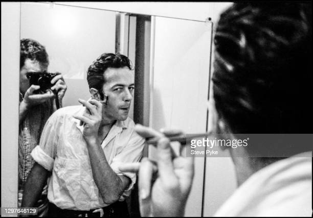 British singer and songwriter Joe Strummer shaving backstage before a concert at The Hollywood Palladium, Los Angeles, California, 12th May 1988.