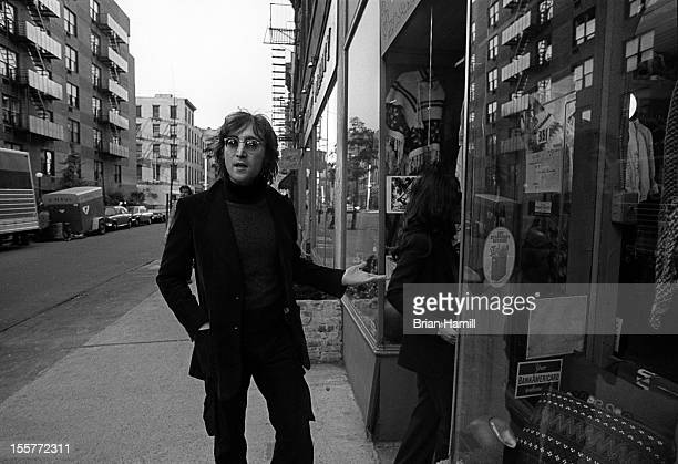 British singer and songwriter John Lennon and his wife Japaneseborn musician and artist Yoko Ono enter a shop in their neighborhood around Bank...