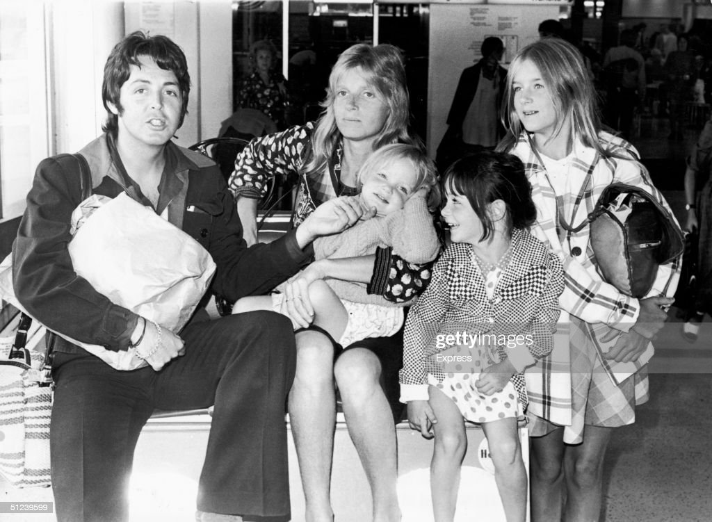 British singer and songwriter Paul McCartney poses with his wife Linda (1941 - 1998), and their daughters, left to right, Stella, Mary, and Heather, at Heathrow Airport in London, England, 2nd August 1974.