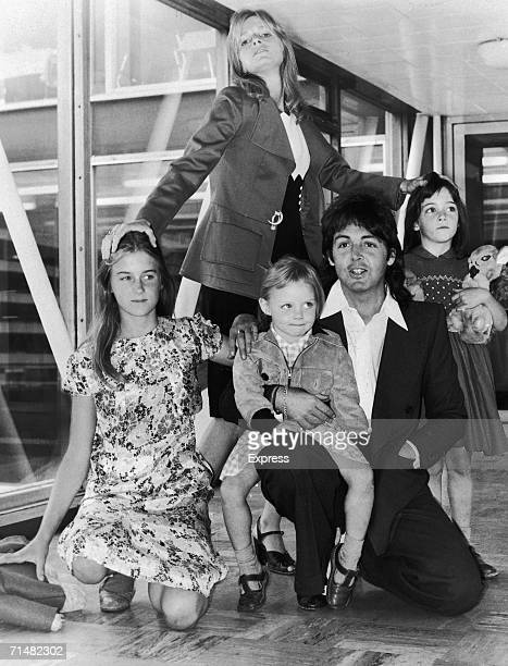 British singer and songwriter Paul McCartney poses with his wife Linda , and their daughters, left to right, Heather, Stella and Mary at an airport,...