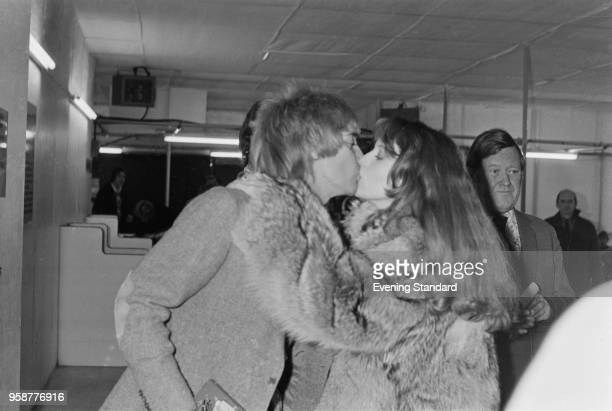British singer and songwriter Rod Stewart kisses his girlfriend American singer and fashion model Bebe Buell UK 11th January 1978
