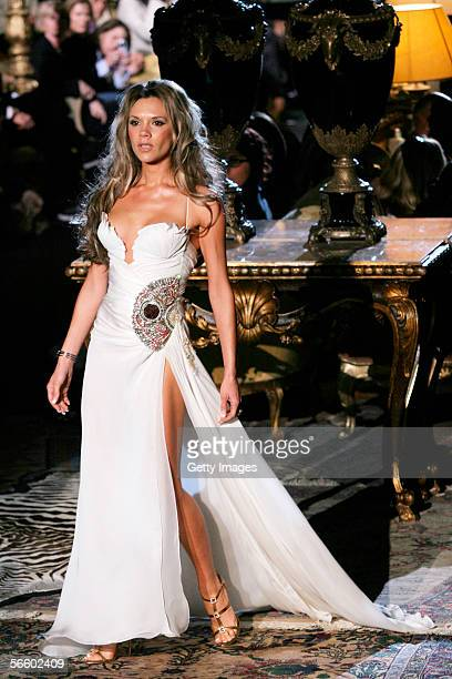 British singer and wife of football player Davis Beckham , Victoria Beckham walk down the runway at the Roberto Cavalli show as part of Milan...