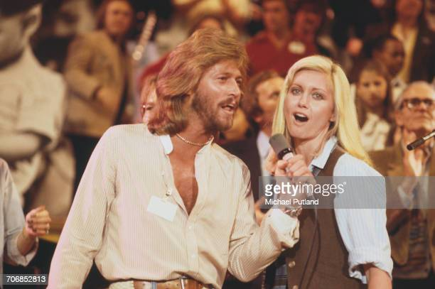 British singer Barry Gibb of The Bee Gees performs live on stage with singer and actress Olivia NewtonJohn at 'The Music for UNICEF Concert A Gift of...