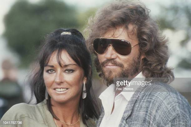 British singer Barry Gibb of The Bee Gees, with his wife Linda at the Cartier polo match on Smiths Lawn, Windsor, UK, 28th July 1985.