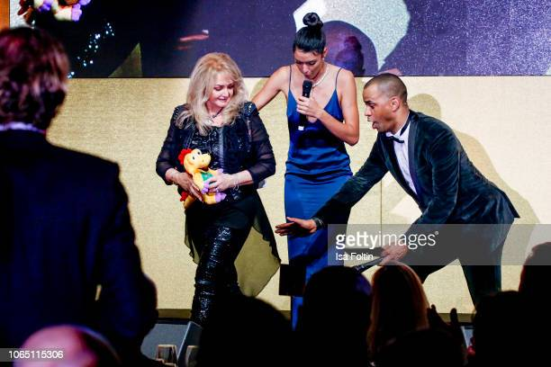 British singer Bonnie Tyler German model and presenter Rebecca Mir and German presenter Patrice Bouedibela during the 10th Laughing Hearts Charity...