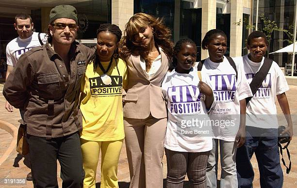 British singer Bono and American singer Beyonce Knowles visit the Baphumele childrens home in the township area of Khayelitsha prior to the 'Give 1...