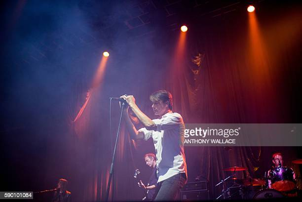 British singer Brett Anderson performs with his band Suede in Hong Kong on August 16 2016 / AFP / Anthony WALLACE