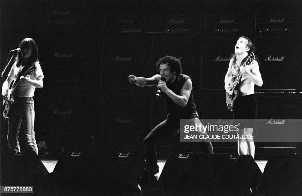 British singer Brian Johnson and guitarists Malcolm Young and Angus Young of Australian legendary hard rock band AC/DC perform at the Palais...