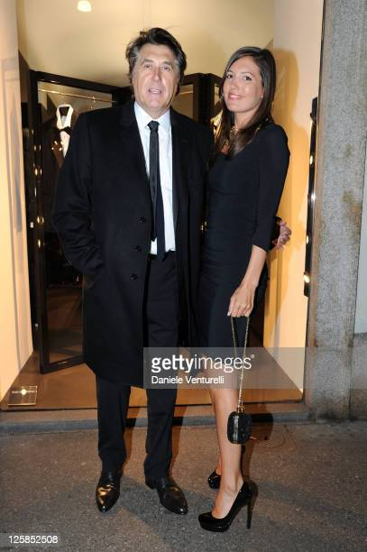 British singer Bryan Ferry and Amanda Sheppard attend the Dolce Gabbana Cocktail In Boutique during the Milan Fashion Week Menswear A/W 2011 January...