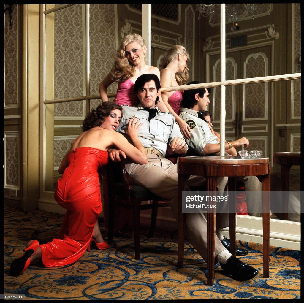 British singer Bryan Ferry of Roxy Music with backing singers Jacqui Sullivan (left) and Doreen Chanter at the Montcalm Hotel, London, 31st October 1975.