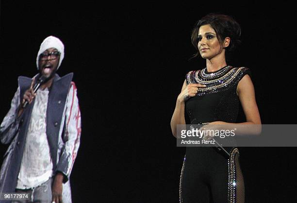 British singer Cheryl Cole performs on stage with a hologram of william of the Black Eyed Peas during the DLD Starnight at Haus der Kunst on January...