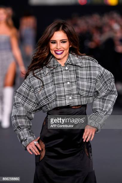 British singer Cheryl Cole takes part in the L'Oreal fashion which theme is Paris on the sidelines of the Paris Fashion Week on October 1 on a...