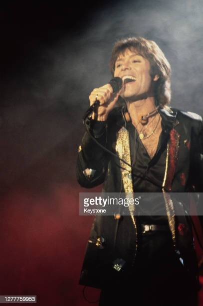 British singer Cliff Richard in concert in at the Hammersmith Odeon in London, UK, 1981.