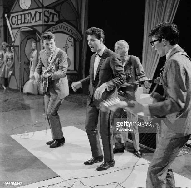 British singer Cliff Richard performs live on stage with Bruce Welch, Jet Harris and Hank Marvin of The Shadows during a recording of Associated...