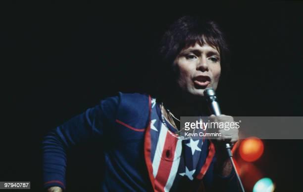 British singer Cliff Richard performs on stage circa 1975