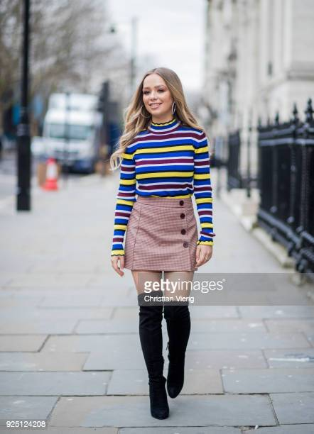 British singer Connie Talbot wearing striped top skirt black overknees boots seen during London Fashion Week February 2018 on February 18 2018 in...