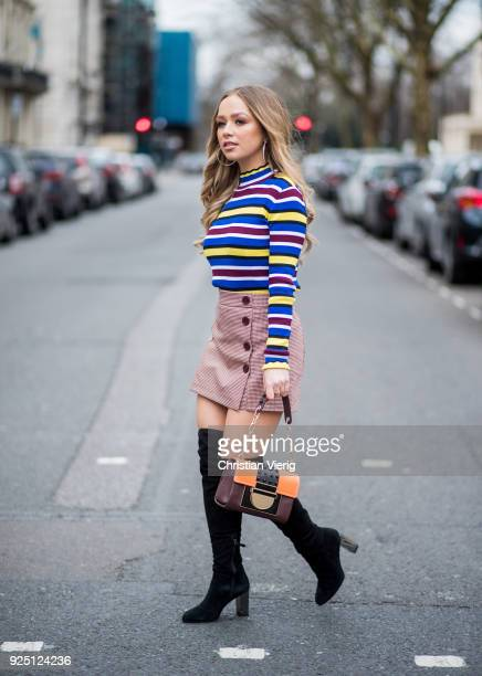 British singer Connie Talbot wearing striped top skirt black overknees boots Aigner bag seen during London Fashion Week February 2018 on February 18...