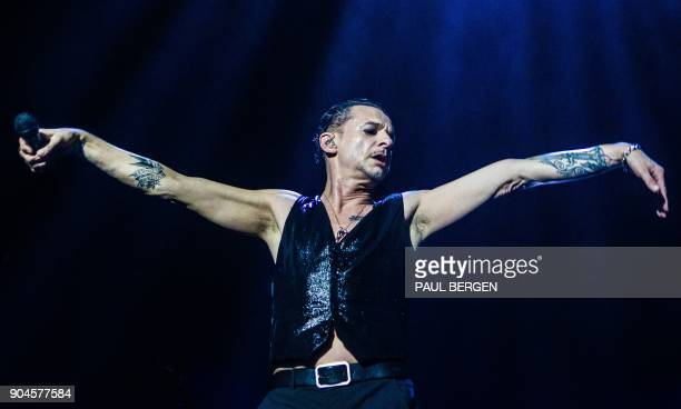 TOPSHOT British singer Dave Gahan of the band Depeche Mode performs during a concert in the Ziggo Dome in Amsterdam The Netherlands on January 13...