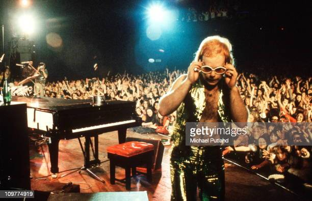 British singer Elton John performing on stage circa 1974.