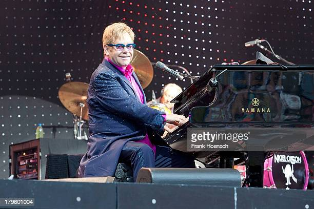 British singer Elton John performs live during a concert at the Waldbuehne on September 5 2013 in Berlin Germany