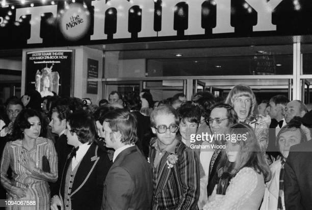 British singer Elton John Scottish rock guitarist and vocalist Davey Johnstone and guests attend the premiere of 'Tommy' British independent rock...