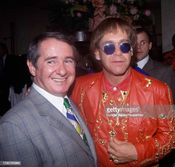 British singer Elton John with his manager John Reid at the opening of the new Versace store in London, England on May 28, 1992. Elton John was close...